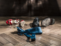 Lot of shoes scattered turns of after the party Royalty Free Stock Images