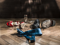 Lot of shoes scattered turns of after the party Royalty Free Stock Photography