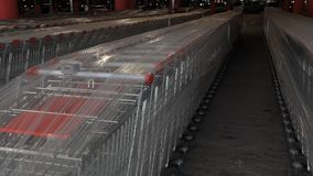 A lot of shopping carts. Abstract defocus blurred of consumer goods in supermarket grocery store., Business retail and customer shopping mall service., Motion stock video