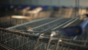 A lot of shopping trolleys near mall