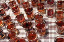 A lot of shots filled with alcohol. Shots filled with rhum on a table royalty free stock photography