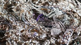 A lot of silver jewelry. Background of silver. 4K 10 bit video stock video footage