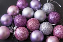 Lot of pink and silver Christmas balls on a black background, Ch. Lot of silver and pink Christmas balls on a black background, Christmas decorations, top view stock images