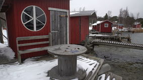 A lot of small fish houses for fishing gear and boats on Baltic sea in winter. Dolly. stock footage