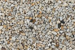 A lot of small stones. Pebbles background. Stock Image