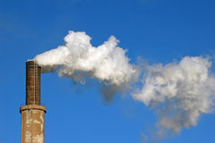 Smoke from chimney at winter Royalty Free Stock Image