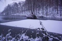 Lot of snow cold winter landscape with lake stock photography