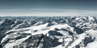 A lot of snowy mountain summits. In winter at austria tyrol Royalty Free Stock Image