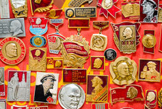 A lot of Soviet Union badges. Many Soviet Union (former Russia) badges on red banner Stock Photo