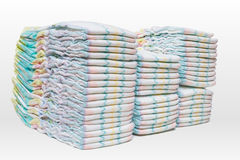 A lot of stacked diapers  on white background Stock Photo