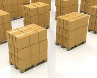 A lot of stacks of carton boxes on a pallets Royalty Free Stock Photography