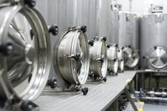 A lot of stainless steel tanks with large round hatches, modern beverage production. Food industry Stock Images