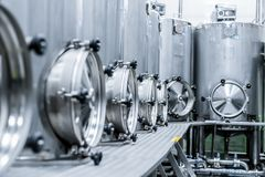 A lot of stainless steel tanks with large round hatches, modern beverage production. Food industry Royalty Free Stock Images