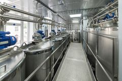 A lot of stainless steel tanks, modern production of spirits. stock photo
