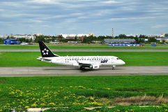 LOT (Star Alliance Livery) Polish Airlines Embraer ERJ-170 airplane  in Pulkovo International airport in Saint-Petersburg, Russia Stock Images