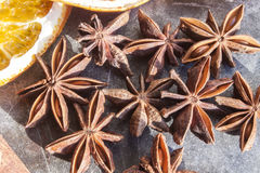 A lot of star anises. Near dried fruit, on a stone plate Royalty Free Stock Images