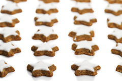 Lot of star shaped cinnamon biscuits Royalty Free Stock Photo