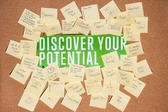 A lot of stickers for notes with text and banner discover your potential on a cork board Royalty Free Stock Photo