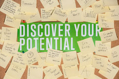 A lot of stickers for notes with text and banner discover your potential on a cork board Stock Image