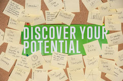 A lot of stickers for notes with text and banner discover your potential on a cork board Stock Images
