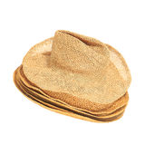 The lot of straw hats isolated on white background. Stock Image