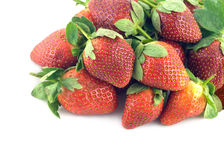 Lot of strawberry fruits isolated on white closeup Stock Photos