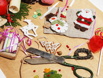 Lot of stuff for handmade gifts, scissors, ribbon, paper with countryside pattern, ready for holiday concept, nobody Royalty Free Stock Image