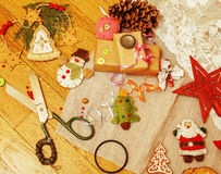 Lot of stuff for handmade gifts, scissors, ribbon, paper with countryside pattern, ready for holiday concept, nobody Royalty Free Stock Photography