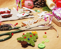 Lot of stuff for handmade gifts, scissors, ribbon, paper with countryside pattern, ready for holiday concept, nobody Royalty Free Stock Photos