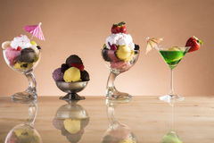 Lot of sundaes with fruits for the hot summer days Stock Images