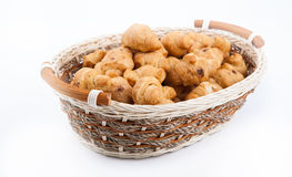 Lot of sweet croissants into a bamboo bowl Stock Photography