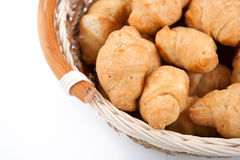 Lot of sweet croissants into a bamboo bowl. Close up Royalty Free Stock Photography