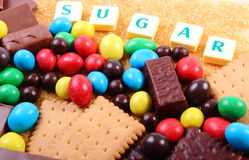 A lot of sweets, brown sugar and word sugar, unhealthy food Royalty Free Stock Images