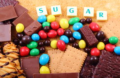 A lot of sweets, brown sugar and word sugar, unhealthy food Stock Photography