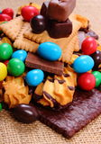 A lot of sweets on jute burlap, unhealthy food Royalty Free Stock Image