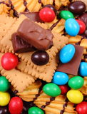 A lot of sweets on jute burlap, unhealthy food Stock Photos
