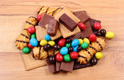 A lot of sweets on wooden surface, unhealthy food Stock Images