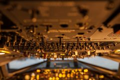 A lot of switches in aircraft cockpit with selective focus. Royalty Free Stock Photography