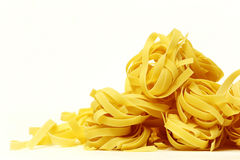 A lot of tagliatelle nest Royalty Free Stock Photography