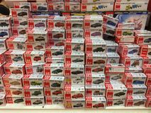 Lot of Takara Tomy diecast model car on shelf Stock Photography