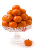 A lot of  tangerines in a vase. Isolated on a white background Royalty Free Stock Photography