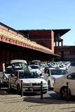 A lot of taxis waiting in front of a train station Stock Images
