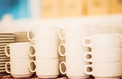 Lot of tea cups stacked one on one, catering on a banquet. Stock Photo