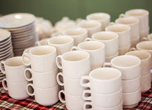 Lot of tea cups stacked one on one, catering on a banquet. Royalty Free Stock Images