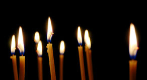 Lot of thin burning candles Royalty Free Stock Photos