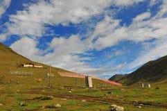 A lot of  Tibetan prayer flags flying wiht Mandala on the hillside Stock Photo