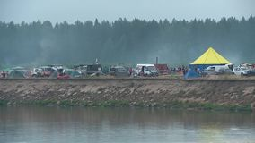 A lot of tourist tents on the river Bank stock video footage