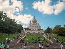 A lot of tourists and citizens on the hillside of Montmartre on the background of the Sacre-Coeur. royalty free stock photos