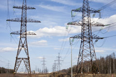 a lot of towers with voltage wires Stock Photos