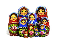 Lot of traditional Russian matryoshka dolls on white Stock Photos